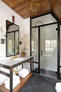 Gorgeous bathroom, those white subway tiles and the contrast with the black trim