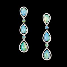Pair of Platinum, Opal and Diamond Pendant-Earrings   Vertically-set with 6 pear-shaped opals approximately 6.00 cts., framed by small round diamonds, spaced by 4 collet-set round opals, approximately 5.8 dwt.