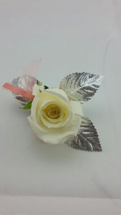 White Rose Boutonniere with Silver and Coral Accent