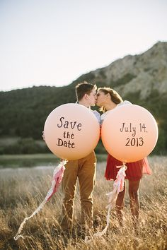 Large balloons with your Save the Date info written on them
