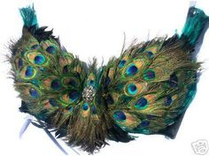 Belly dancing peacock feathers