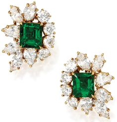 Harry Winston emerald and diamond earrings. Via Diamonds in the Library.