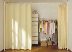 Idea for creating larger closet space--nest the bed inside the actual closet and put clothing racks behind floor to ceiling curtains elsewhere in the room!
