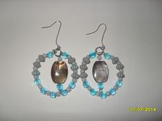 Beaded hoop earrings with brown acrylic beads in the center.
