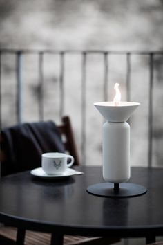 A field full of poppies were the inspiration behind the design of these modern outdoor oil lamps.