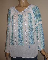 Hand embroidered and hand sewn Romanian peasant blouse , embroidered in blue and green cotton thread on sheer white gauze cotton . Delicate hand embroidered blouse .