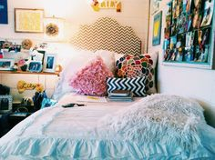 Love the white duvet with colorful accents around the room!