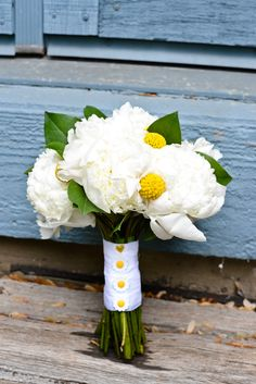 White and Yellow Wedding:  White peonies, craspedia, and salal tips.  Designed by Whimsical Welcomes Floral Design Skippack PA  DLutzphoto.com