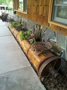 Cute way to use old farm equipment parts. I think a bench would be cute too.