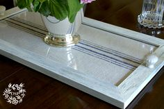 DIY Grain Sack Tray - Learn how to make this tray using a picture frame and your favorite fabric.