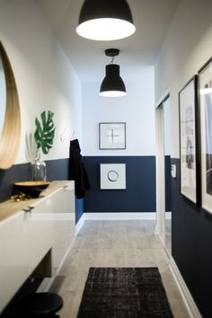 navy blue home accents Long condo entryway with navy blue lower half walls Condo Living, Home, Half Walls, Half Painted Walls, Condo Decorating, Condo Design, Hallway Designs, Small Condo Decorating, Blue Hallway