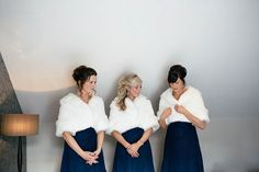 Bridesmaids in navy blue and fur wraps for a winter wedding.  http://www.candysnaps.co.uk