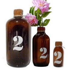 like the small brown bottle - wuold look good with the wood and mason jar look ...table numbers