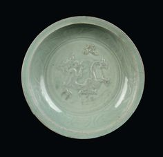 A rare Longquan Celadon plate with dragon in relief, China, Yuan Dynasty (1279-1368).PhotoCambi Casa dAste