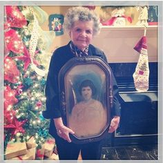 Grandmother holding a portrait of her grandmother