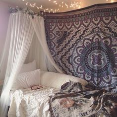 Tapestry, white sheer bed curtains, and string lights on ceiling. Simple and beautiful!