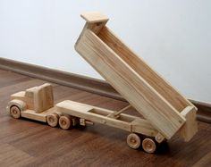 Daphne the dump truck - a wooden toy with movable bed