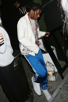 ASAP Rocky wearing  Himumimdead Custom Denim Jacket, Himumimdead Shanked Shania Twain T-Shirt, Goyard Small Urbain Messenger, Adidas Superstar Track Pants