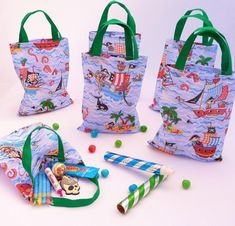These wonderful bags are handmade from a high quality cotton fabric featuring a bright, fun design of Pirates and pirate ships. Each bag features a pair of double thickness coordinating green cotton fabric handles. The size of each bag (without handles) is: 18cm wide x 22cm high and 3.5cm deep when expanded, so plenty of space for lots of party bag goodies and a generous slice of cake or large cupcake. Pirate Party Favors, Pirate Theme, Cotton Bag, Cotton Fabric, Green Cotton, Plastic Gift Bags, Large Cupcake, Party Giveaways, Party Gift Bags