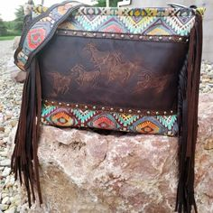 Summer is finally upon us! What's trending in accessories this season? All things custom! From beadwork to tooled leather, custom brands, and interchangeable trophy buckle mounts. Want to stand out in style this season? Look no further than Wild Lace Beadwork for your custom handbag!