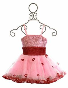This lovely dress from Ooh La La Couture is sure to be one your daughter's favorites! The bodice of the dress is covered in sparkling pink sequins and features a straight across neckline and thin adjustable straps. The waist of the dress is brought together with a red sash created with red satin and synched elastic. A large satin bow sits at the back of the waist just above the full tutu skirt. The skirt is fashioned in a tutu style with light pink tulle embroidered with little red lip…