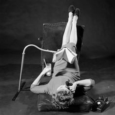 A decade before the Consumer Electronics Show began in Las Vegas, inventors convened in New York for the 1958 International Gadget and Invention Show. Below, a woman uses one of the inventions to multitask while reading. See more: http://ti.me/1xAEKmu  (Ralph Morse—The LIFE Picture Collection/Getty Images)
