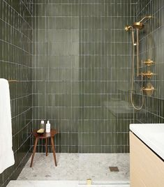 This gorgeous bathroom with green tile and brass accents in a modern oasis from Fireclay tile Green Subway Tile, Subway Tiles, Olive Green Bathrooms, Green Bathroom Tiles, Green Tiles, Blue Bathrooms, Ceramic Tile Bathrooms, Farmhouse Bathrooms, Contemporary Bathrooms