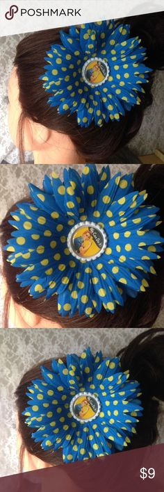 "Rose the Riviter Hair Flower Clip This adorable hair flower is up for grabs! As a lot of you know I make a wide range of jewelry & accessories. I also vend my stuff at events and usually come home with only a few pieces left. This is one of them💙💛Hair flower measures almost 5"" around. Blue with yellow polka dots and a Rosie the Riviter cap for the center. Flower is nice & secure and will stay in place all day! Alligator clip for the back. Handmade by me! Tags: retro, vintage, rockabilly…"