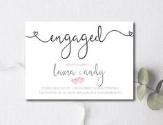 engagement party invitation with small pink hearts and cursive script