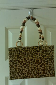 Growl like a leopard with this faux skin duct tape bag with wooden beads for the handles.