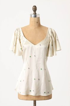 Anthropologie.com...Creek ripples and watercolor pebbles wash over HD in Paris' silken, butterfly-sleeve canvas.  Removable tie $128