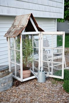 DIY window greenhouse - See how to make this amazing rustic greenhouse. A super easy DIY project that adds rustic charm indoors or outdoors. A great pin for DIY farmhouse decor! - I need to make one of these for my hibiscus tree! Diy Greenhouse Plans, Small Greenhouse, Greenhouse Gardening, Homemade Greenhouse, Old Window Greenhouse, Outdoor Greenhouse, Portable Greenhouse, Gardening Tips, Balcony Gardening