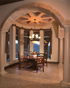 Beautiful dining room with arched entrance-way and stunning views