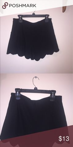 Brand new black scalloped shorts size medium So cute! Brand new, tags still attached! Black shorts with front pockets and one pocket in the back. There's a zipper on the side. Size medium. 100% polyester. There is lining inside. Shorts
