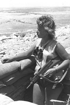 Female Israeli with Uzi on guard duty in the Negev, 1956.