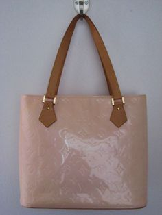 Louis Vuitton vernis leather 'Houston' tote. Marshmellow pink patent leather tote with 2 leather straps. Top zip with wide base. Leather lining 2 open & 1 zip pocket.