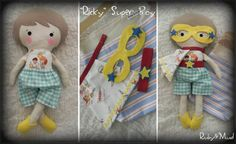 """Ricky"" Super-Boy doll set. An amazingly fun set for any little superhero! Set includes cute ""Ricky"" doll, removable shoes, shorts, mask, belt, cape and tote bag!"