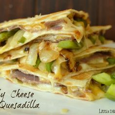 Philly Cheese Steak Quesadilla flour tortillas  ¼ green pepper, sliced  ⅛ onion, sliced  2 T. butter (divided)  3 sliced deli roast beef lunch meet  ¼ cup cheddar cheese, grated  ¼ cup pepper jack cheese, grated  ¼ cup Swiss cheese, grated