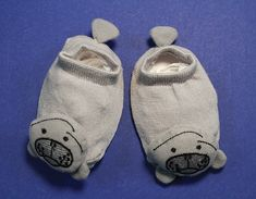 Don't go another day without having a pair of these manatee booties! They are super cute, and perfect for any baby from newborn age to one year old. These are not your ordinary baby booties, there is a 3D manatee face on the front, flippers on the sides, and a tail on the back. This is the cutest pair of booties that you will ever find, don't pass them up!