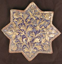 Tile with 'Lajvardina' Glaze Object Name:Star-shaped tile Date:second half 13th–14th century Geography:Attributed to Iran Medium:Stonepaste; molded, overglaze painted, and gilded (lajvardina) Dimensions:H. 7 7/8 in. (20 cm) W. 7 7/8 in. (20 cm) D. 3/4 in. (1.9 cm)