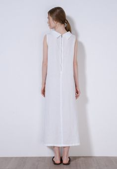 Long dress made of cool and delicate pure linen.  The A line has a wide, flared fit. The clean and essential line is characterised by the particular collar and zip back. Above ankle length.