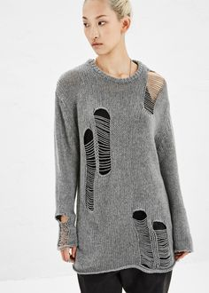 Long-sleeved sweater in grey woven cashmere. Rounded collar with knit detail. Pulled stitch detail on front, shoulder and back of sleeves. Dry clean only.