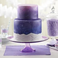 Snow Swirls Fondant Cake - Cool and colorful, this fondant-covered cake is perfect for every magical winter celebration. Cover the cake using Wilton® White Decorator Preferred™ Fondant and add the striking color with Wilton Color Mist™ Food Color Spray.