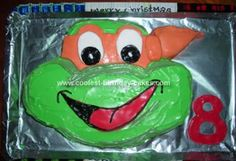 Homemade Ninja Turtle Birthday Cake: My nephew wanted a Ninja Turtle Birthday Cake, so I looked up pictures on the internet and made a template out of cardboard.   I used a rectangular cake
