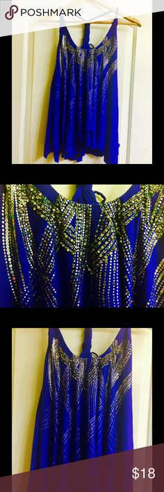 95% rayon acecemetrical rhinestone beaded tank top 95% rayon royal blue asymmetrical layered racer back tank top, size small by miss me, tank is asymmetrical all over & has a layered look see pics for details, braided straps front has rhinestones and beads, also has a rainbow metallic silver dotted design on front throughout with the rhinestones and beads, only missing two rhinestones, a couple tiny beads missing here and there which you can't tell either but this tank top is gorgeous and…