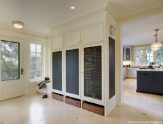 ---> Great idea for an open yet divided floor layout. Chalkboard cabinets could disguise a pantry, cleaning supply and coat closet.