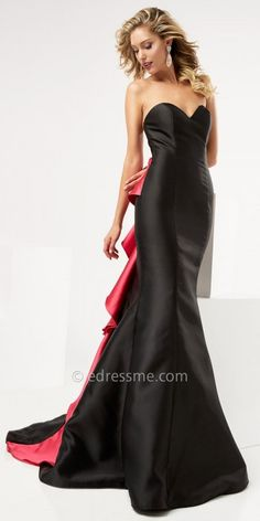 Make a dramatic statement at your next soiree in this Color Blocked Strapless Ruffled Back Evening Dress by Jasz Couture. This chic style includes a classic strapless sweetheart neckline and a mermaid silhouette. The focal point of this style is the back as it features a keyhole cut out and a dramatic contrasting cascading ruffle. #edressme