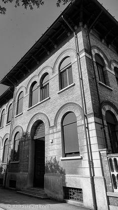 The Scuola Elementare, designed by Arnaldo Fuzzi in 1932. This building provides an example of repetition of architectural elements as decoration, both for windows and the fence.