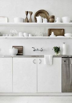Why hide beautiful dishes behind cabinet doors? This kitchen remodel used thick open shelving