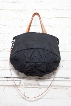 Waxed cotton & leather tote by Genevieve Savard on Etsy.
